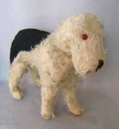 -I would love to have this little fellow:ceeanne....antique mohair stuffed dog.