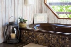 stone instead of tile on the side of the bathtub. bathroom  //  Jeannie and Freddy's Rustic Meets Luxe Home in the Hills
