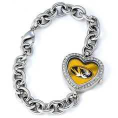 """BSS - Missouri Tigers NCAA Ladies Heart Series Watch . $76.90. BSS - Missouri Tigers NCAA Ladies Heart Series"""" Watch"""" The Heart Series features a bold full-colored face with an Offical Team logo. It features a heart shaped metal case with glistening rhinestones surrounding the genuine glass crystal. The bracelet is adjustable and made of stainless steel. The watch has the accuracy and reliabilty of a Japan Quartz movement; and is water resistant to 3 AT..."""