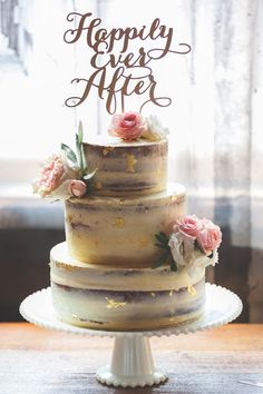 Gold Flaked Naked Wedding Cake for Kayla & Konstantin's Wedding at Archeo in The Distillery District, Toronto. A vanilla buttermilk cake with coffee cardamom filling and vanilla white chocolate butter (Wedding Cake Toppers)