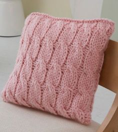 Big Cables Pillow in Red Heart Grande, a beautiful cushion to add to your home! Find this FREE pattern and more inspiration at LoveKnitting.Com.