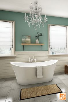 Pair a decadent chandelier with a deep freestanding statement tub for the ultimate personal luxury bathroom experience. Learn more at homedepot.ca .