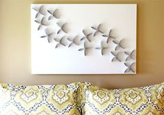 kreative wandgestaltung wohnzimmer mit bilderrahmen Wanddekoration aus Papphülsen