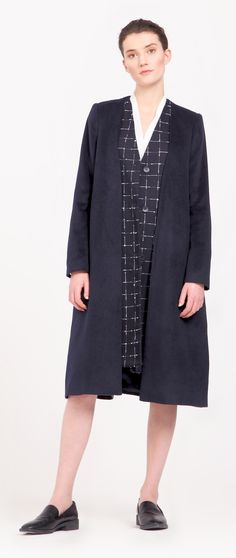 This V-neck collarless coat is designed with double front layers and textured checked under layers for a trompe l'oeil effect, with front button fastenings and a back vent. http://www.paisie.com/collections/coats-jackets/products/double-layer-collarless-coat