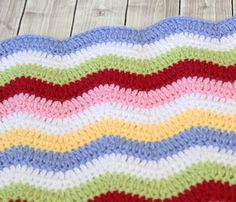 The Rainbow Ribbons Crochet Baby Blanket Pattern is a classic crochet ripple design that is easy to memorize! | AllFreeCrochetAfghanPatterns.com
