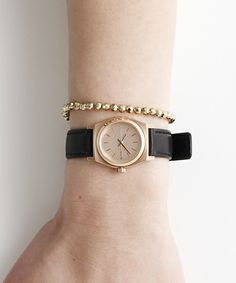The Nixon Small Time Teller Watch is out. The leather band combined with the rose gold silver case and face makes the watch elegant. This is the perfect watch for any women who wants to be on time.