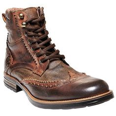 Steve Madden's Gastonn Wing Tip Boot is a top-notch choice for the weekend. Featuring a thick round lace, a heel tab, and burnished details, this studded boot pairs well with khakis and jeans alike. C