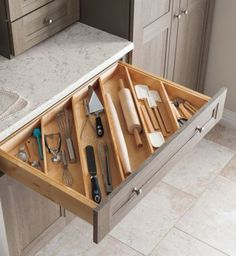 Place diagonal wooden dividers within your drawers to organize and easily access kitchen utensils.