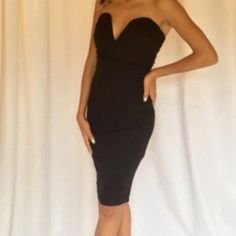 Stunning black strapless dress Beautiful black sweetheart neckline strapless dress hugs your curves and flatters your body model is 5'4 and wearing a small Dresses Strapless