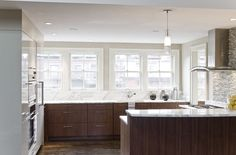 walnut and white cabinets mixed with marble countertops