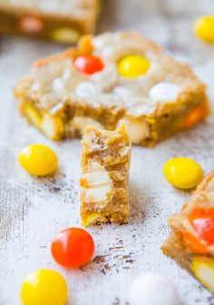 Made with Reese's Pieces and choc. chips…easy and delicious!  - Candy Corn White Chocolate M&M Blondies - Fast, Easy, One-Bowl, No-Mixer Recipe at averiecooks.com