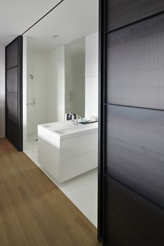 Industrial modern interior design, washroom. The Canal House renovated by HI-MACS® and designed by Witteveen Architects. Currently being featured on www.martynwhitedesigns.com