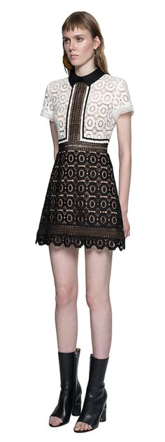 Self portrait. This feminine mini dress combines floral lace with diamond trim inserts. The sculpted A line skirt gives a structured silhouette and features diamond trim detail at the hem. The dress has a nude bandeau and skirt lining and fastens at the back with an exposed zip.