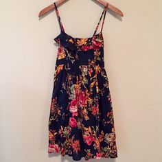 Floral Sun Dress Navy floral dress with empire waist and Ruffles at the top. Ties in the back. Adjustable straps. Size medium. Dresses