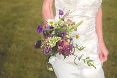 Wild flower bridal bouquet. Autumn wedding. Purple, peach, mauve, lilac, green flowers. With giant daisies.  Cornwall wedding.  White & Bell Photography Wedding and event photographers. Cornwall and the south west. Www.whiteandbell.co.uk
