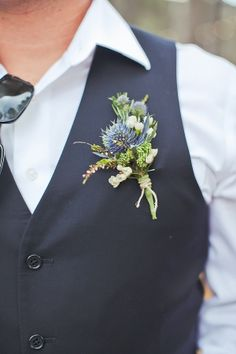 blue thistle boutonnieres with rosemary for the groomsmen & other gentlemen, then add some purple gomphrena to the groom's boutonniere