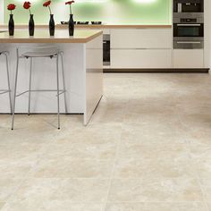 Polyflor Camaro Portico Limestone 2334 Vinyl Flooring provides an alternative appearance to that of Classic Limestone. Featuring a delicate arrangement of subtle colours and a heavier surface texture, this refined replication of the natural material is available in a rectangular tile for an alternative aesthetic, ideal for inlaying with Grouting Strips. The first image displayed is installed in a Herringbone design with Graphite Grouting Strip. The second image shows Portico Limestone…