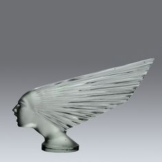 René Lalique Glass 'Victoire'. A superb early 20th Century Art Deco car mascot by René Lalique, this highly sought after clear and frosted glass car mascot fashioned as the Spirit of the Wind is the most iconic of all René Lalique's car mascots and very rare to find in such good condition. Signed R Lalique. A real collector's item