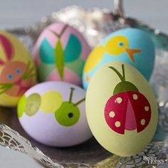 Fashion cute and creative crawlers out of pastel origami paper and adhere to dyed Easter eggs! For more creative ways to dye Easter eggs, look here: http://www.bhg.com/holidays/easter/eggs/quick-and-easy-easter-egg-decorations/?socsrc=bhgpin031315decoupageeastereggs&page=9
