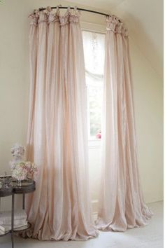use a curved shower rod for window treatment... I really kind of like this. Its elegant and would be REALLY awesome in a princess themed bedroom with rich fabric. Good for canopy too