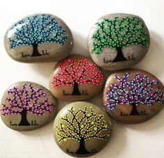 Get inspired with dotted tree of life and seasonal tree rock painting design ideas. For more painted rock and stone art ideas, visit I Love Painted Rocks.
