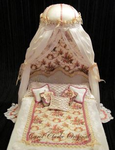 double domed canopy bed with silk fabrics ~ http://dollshouseinterior.co.uk/dressed_beds_for_sale.htm#