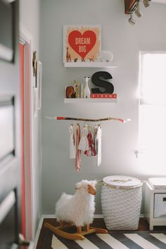 Cute way to hang baby clothes out in the open. Painted pink and gold branch to add a girlie modern look. Love this idea!