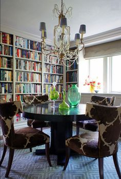 Duel-purpose dining room / library by Christopher Burns Interiors.