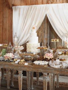 In a classic southern style, the dessert table was simply overflowing with tasty treats and was offset with a simple, unfinished wood wall.