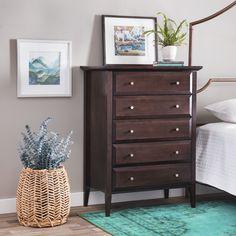 Maximize and enhance your living space with this gorgeous five-drawer chest. This contemporary wooden chest features durable rubber wood and a Halifax finish.  With its spacious five drawers, this chic chest is welcoming in any space.