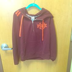 Victoria's Secret quarter zip Never worn! I took the tags off before I tried it on and it was too small for me. Burgundy with bright pinkish/orange writing. PINK Victoria's Secret Tops Sweatshirts & Hoodies