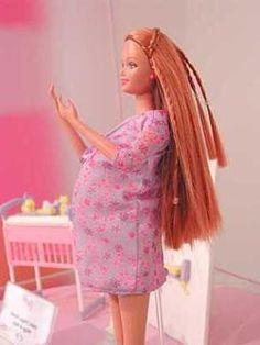 pregnant barbie doll... the stomach was replaceable... once the baby was out... u put the flat tummy on!!!:P