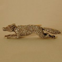 Victorian period diamond fox brooch mounted in silver and 18kt gold with ruby eyes, England circa 1870