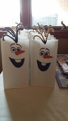 Olaf treat bags for Maddie's Frozen party. Use ribbon instead of pipe cleaner