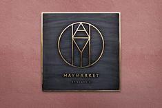 Haymarket brass sign