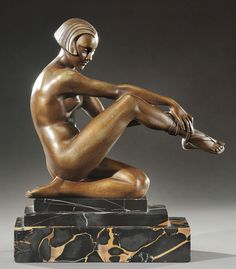 PIERRE LAUREL Art Deco bronze of a nude woman lacing her sandals, marble base. Signed «P.Laurel»,