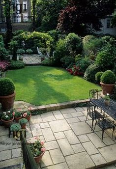 Harpur Garden Images :: CM200 Small formal town garden with paved patio, dining table and chairs, lawn, containers, borders, arch dividing s...