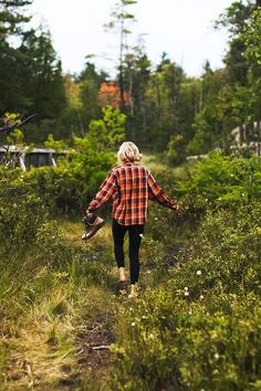 walking barefoot through the field. plaid flannel
