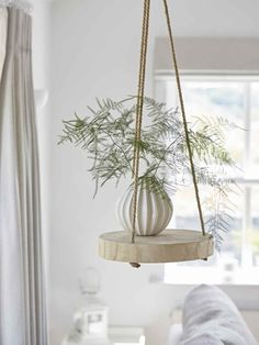 Add a contemporary classic to your home with our rustic hanging shelf, made from beautiful palownia wood with knotted rope to hang it from the ceiling. Hanging Rope Shelves, Ceiling Hanging, Plant Shelves, Ceiling Decor, Hang Plants From Ceiling, Ceiling Shelves, Floating Shelves, Rustic Shelves, Wooden Shelves