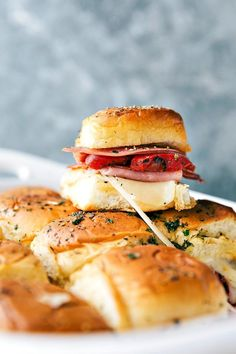 Easy baked Italian sliders with ham, salami, pepperoni, roasted red peppers, and provolone. These sliders are so quick and easy to make!
