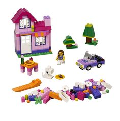 LEGO Pink Brick Box. Features female mini figure, lots of basic bricks and accessories, such as plate, croissant, tyres, windows, door and steering wheel. Sturdy, reusable Lego brick storage box included. Easy-to-follow building instructions & download additional building instructions at creative.Lego.com. Build a castle, a summer holiday house and selection of accessories