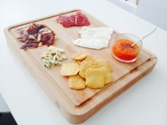 Farinsol Crackers, Roquefort, Spanish Ham, Catalonian Sausage, Farmer Cheese and Tomato