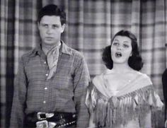 Rita Cansino (Hayworth) and Robert Livingston,    singing a duet in ''Hit theSaddle'' , B western from Republic