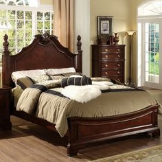The Ambrosio Formal Dark Cherry Bed will add sophistication to any bedroom decor with great detailed finial carvings and elegant sturdy post supports. The bed comes with Cal king and queen size option
