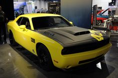 Dodge Challenger 1320 with it's very own custom hood. This car is very fast and was toured at the SEMA car show back in 2009