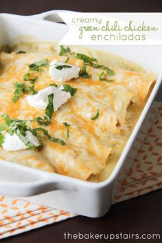 Creamy green chili chicken enchiladas from The Baker Upstairs. These enchiladas are so creamy and flavorful and delicious! Perfect for Cinco de Mayo or anytime! http://www.thebakerupstairs.com