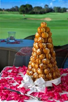 "croquembouche or ""piece montee"" is a French wedding cake made from filled choux buns held together with caramel in an impressive pyramid.    Royal Adelaide Golf Club desserts"