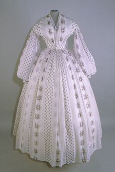 Date Made: c.1860-65  Description:  Dress; white and purple cotton print dress with v-neck.