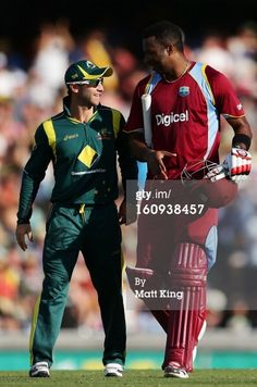 News Photo : Kieron Pollard of West Indies speaks to Phillip...