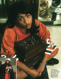 Lil Kim holding Biggie's ashes. R.I.P. Biggie
